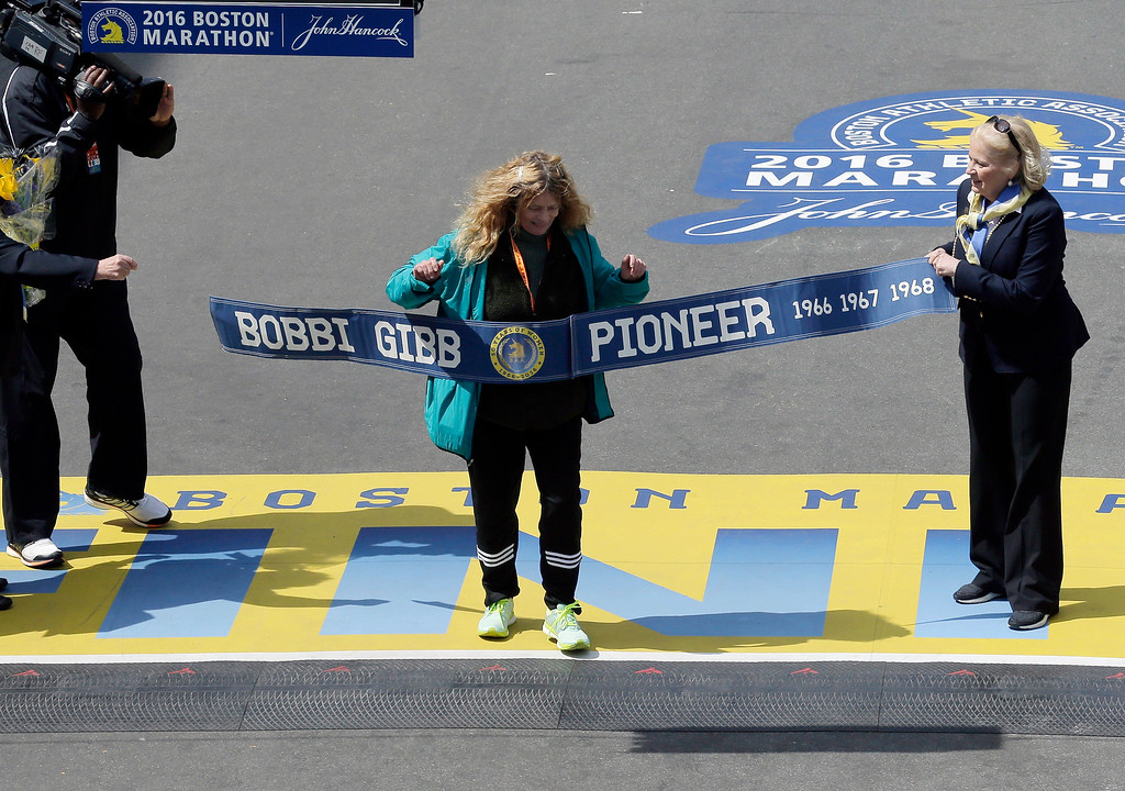 . Bobbi Gibb, first woman to run the Boston Marathon in 1966, crosses the finish line for photographers during the 120th Boston Marathon on Monday, April 18, 2016, in Boston. (AP Photo/Charles Krupa)