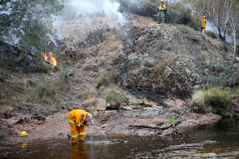 Fire fighter Roger Walkvin washes his face with water from a stream as a joint Australian and U.S. strike team blackline an area in order to control a bushfire and protect nearby structures, in Alpine National Park near Omeo, Victoria, Australia, January 12, 2020. The Australian firefighters are with Country Fire Authority Australia and the U.S. team is the third rotation in for 28 days and they come from five different U.S. agencies, the U.S. Forest Service, U.S. Fish and Wildlife, Bureau of Land Management, Bureau of Indian Affairs and the National Park Services.