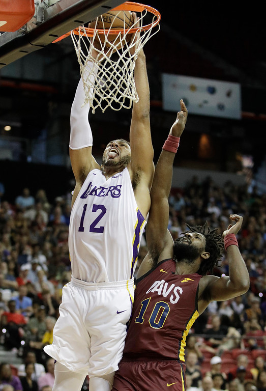 . Los Angeles Lakers\' Jeff Ayres dunks over Cleveland Cavaliers\' John Holland during the second half of an NBA summer league basketball game, Monday, July 16, 2018, in Las Vegas. (AP Photo/John Locher)