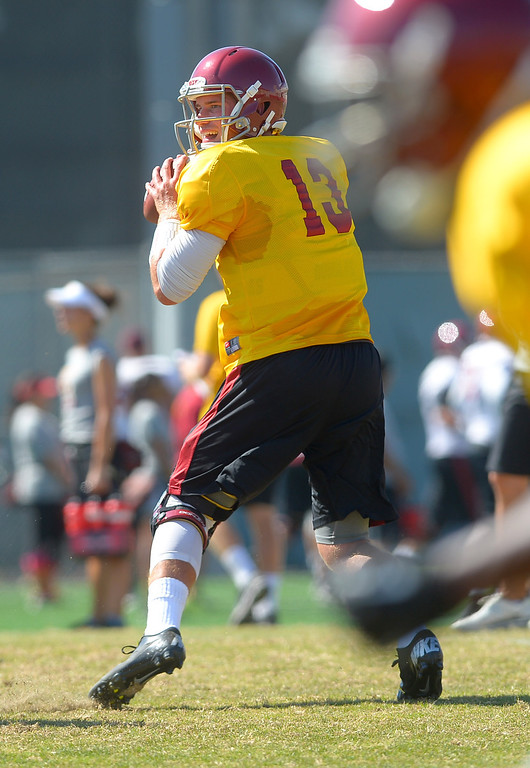 . Quarterback Max Wittek looks to pass during USC practice August 20, 2013.(Andy Holzman/Los Angeles Daily News)