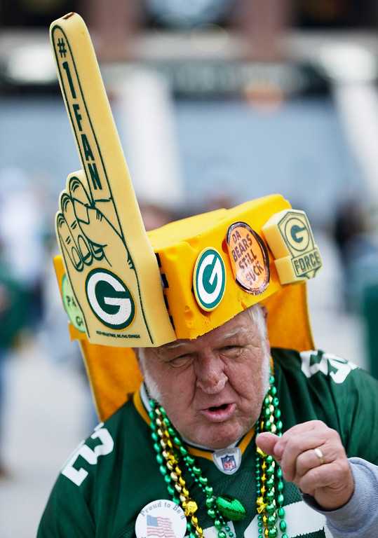 . Green Bay Packers fan Gene Greening cheers before NFL football game against the Chicago Bears Monday, Nov. 4, 2013, in Green Bay, Wis. (AP Photo/Mike Roemer)