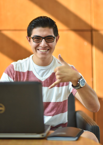 Stevie Espinoza works on his accounting home work in the O'Connor lobby.