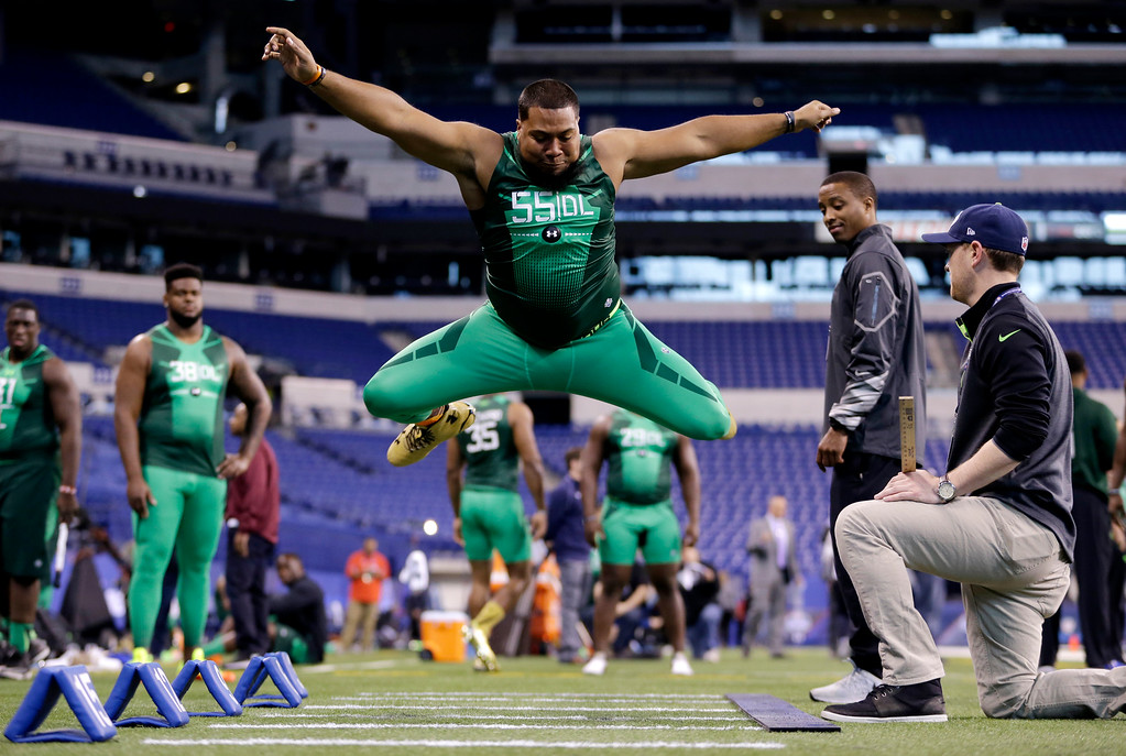 . Auburn defensive lineman Gabe Wright runs a drill at the NFL football scouting combine in Indianapolis, Sunday, Feb. 22, 2015. (AP Photo/Julio Cortez)