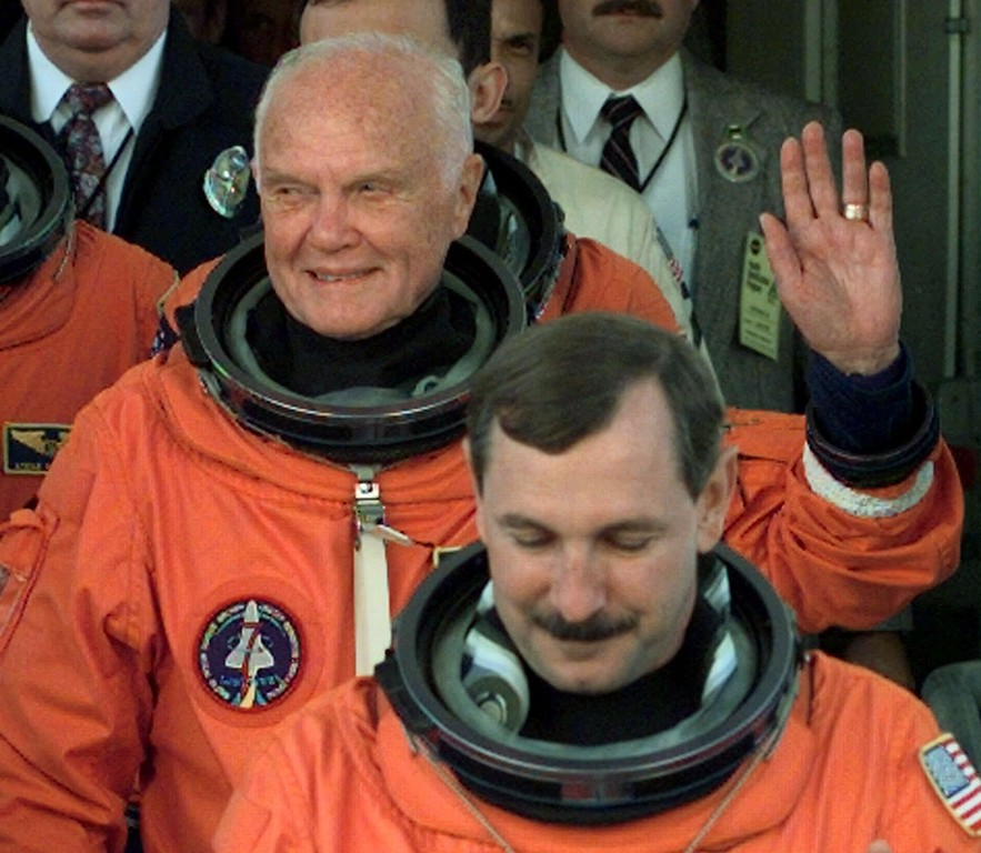 . Sen. John Glenn, D-Ohio, waves as he leaves the Operations and Checkout Building Thursday morning Oct. 29, 1998 at Kennedy Space Center. Glenn, Commander Curt Brown, front, and five other crew members were on their way to Launch Pad 39-B and a planned liftoff on the Space Shuttle Discovery. (AP Photo/Chris O\'Meara)