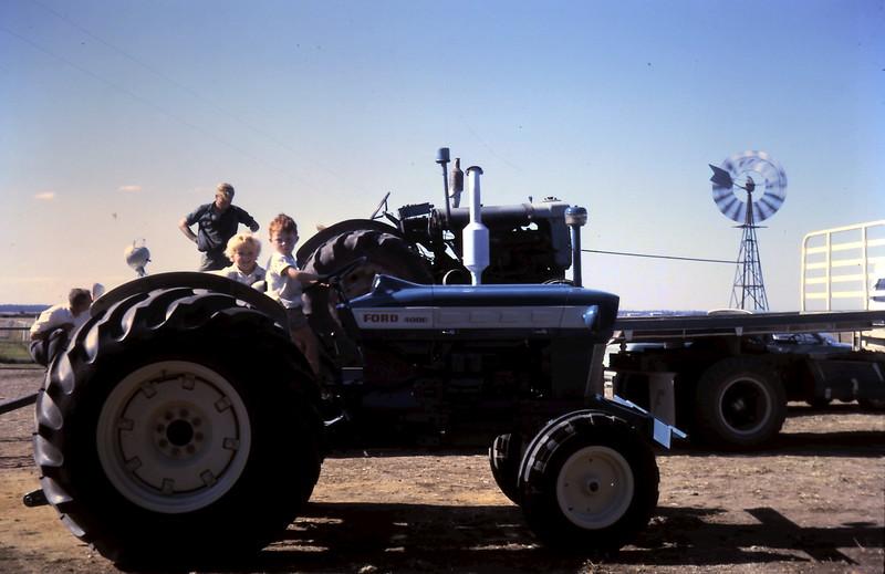 1968-4 (13) David 4 yrs 4 mths, Susan 2 yrs 9 mths on new tractor.JPG