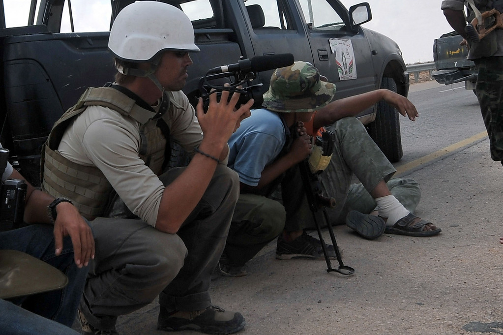 . A photo taken on September 29, 2011 shows US freelance reporter James Foley (L) on the highway between the airport and the West Gate of Sirte, Libya. Foley was kidnapped in war-torn Syria six weeks ago and has been missing since, his family revealed on January 2, 2013. Foley, 39, an experienced war reporter who has covered other conflicts, was seized by armed men in the town of Taftanaz in the northern province of Idlib on November 22, according to witnesses. The reporter contributed videos to Agence France-Presse (AFP) in recent months.           (ARIS MESSINIS/AFP/Getty Images)