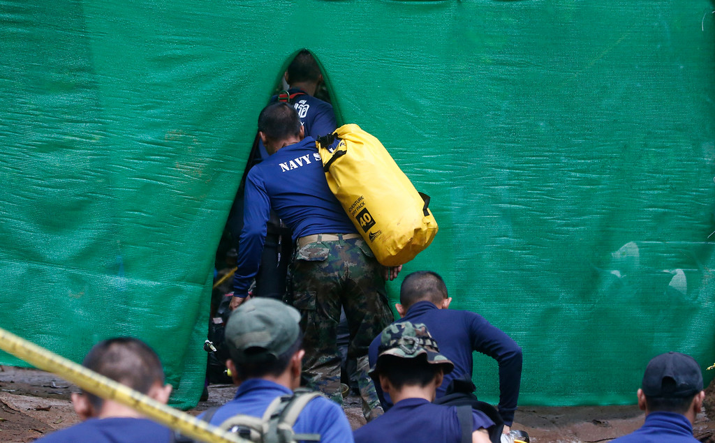 . Rescuer arrive near cave where 12 boys and their soccer coach have been trapped since June 23, in Mae Sai, Chiang Rai province, in northern Thailand Sunday, July 8, 2018. Thai authorities are racing to pump out water from the flooded cave before more rains are forecast to hit the northern region. (AP Photo/Sakchai Lalit)