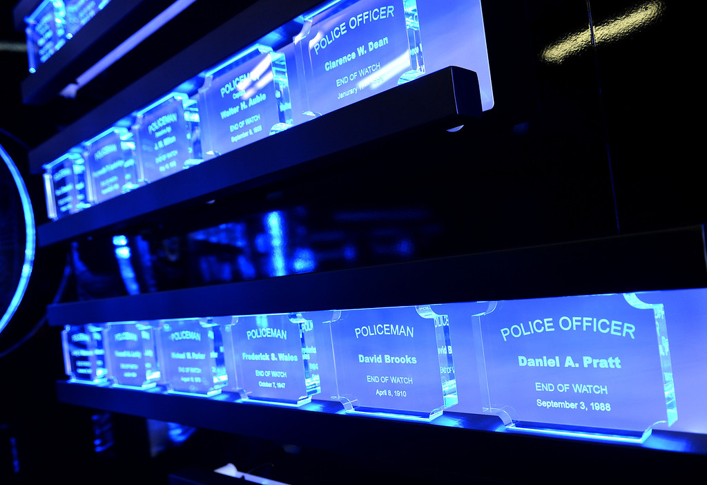 . The Los Angeles Police Protective League and the Eagle & Badge Foundation unveiled new End of Watch Memorial Wall featuring the names of the 206 officers who have died in the line of duty. The 60 ft. wide and 9 ft tall wall was made at Commemorative Badge Company in Gardena where it was unveiled. The names of officers glow in blue light.        Photo by Robert Casillas / Daily Breeze