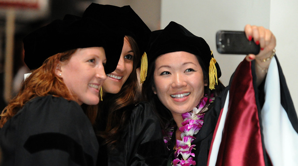 . Clinical Psychology graduates Amy Sickel, left, Nicole Robello, center, with Jennifer Ku take a self portrait during the summer commencement ceremony at Azusa Pacific University on Friday, July 26, 2013 in Azusa, Calif.  (Keith Birmingham/Pasadena Star-News)