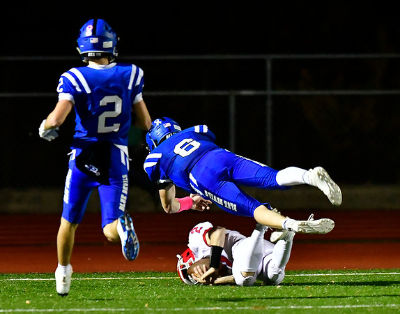 10/25/2019 Mike Orazzi | StaffrBerlin High School's Jamie Palmese (2) hauls in a late second quarter TD pass during Friday night's football game with Plainville at PHS.
