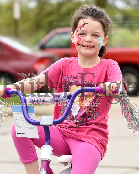 Harold Aughton/Butler Eagle: Jayden Speed, 6, of Butler takes a spin on her new bicycle at the Butler City bike rodeo aimed at children, ages 5-15. Includes free giveaways. Participation by State Police, Butler City Police, YMCA, city fire vehicles, United Way Butler Ambulance, Butler Lions Club