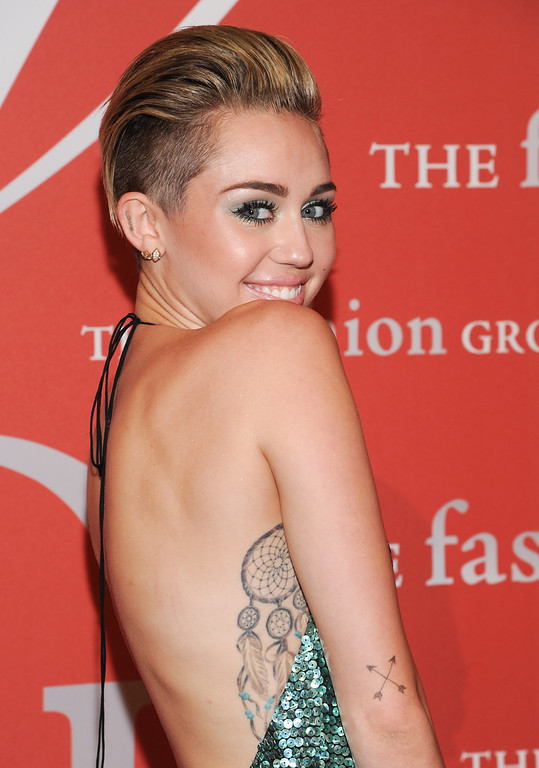 ". Singer Miley Cyrus attends the Fashion Group International\'s 30th annual ""Night Of Stars\"" awards gala at Cipriani\'s Wall Street on Tuesday, Oct. 22, 2013, in New York. (Photo by Evan Agostini/Invision/AP)"