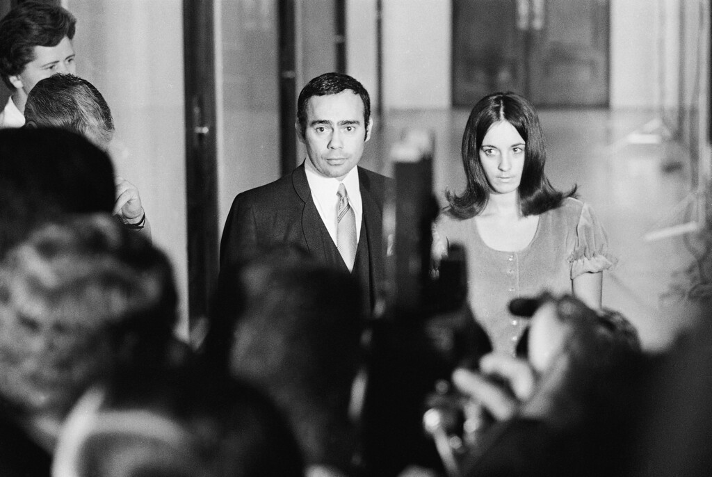 . Susan Denise Atkins, 21, a key witness in the Sharon Tate murders case, emerges with her attorney, Richard Caballero, from the grand jury room, Dec. 5, 1969, in the Los Angeles Hall of Justice with her story of what happened the night of the slayings only partially told. She was to return after a noon recess to complete her testimony. (AP Photo)