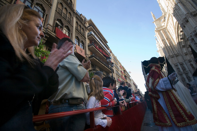 People applauding a Holy Week procession, Seville, Spain