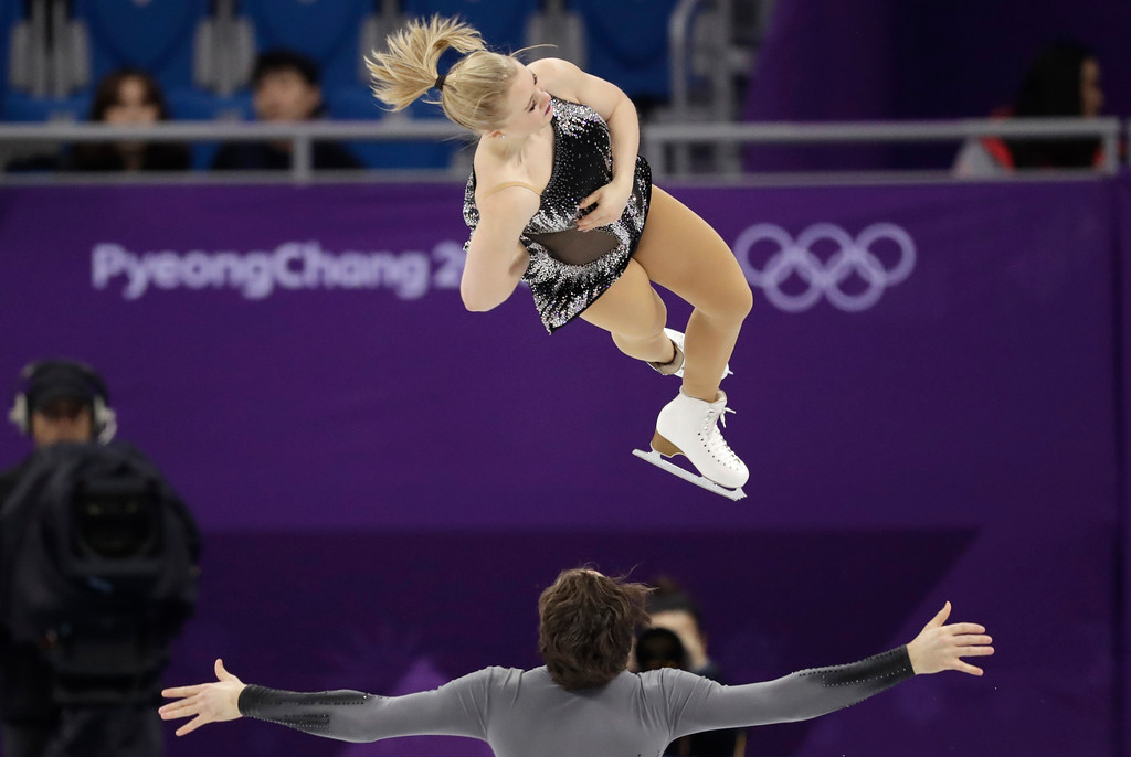 . Julianne Seguin and Charlie Bilodeau of Canada perform in the pair figure skating short program in the Gangneung Ice Arena at the 2018 Winter Olympics in Gangneung, South Korea, Wednesday, Feb. 14, 2018. (AP Photo/Bernat Armangue)