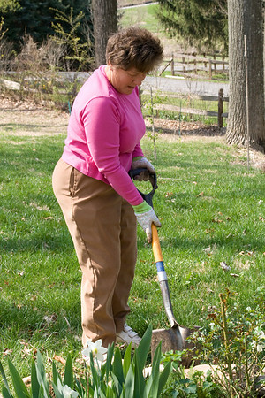 Patti Holcombe helping with flower beds April