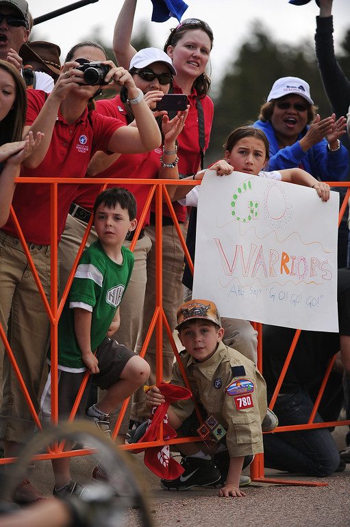 . Colin Cahill, 9, in boy scout uniform and his sister Paige, 11, with sign cheer on athletes during the cycling races. The fourth annual Warrior Games cycling event took started and finished at Falcon Stadium on the grounds of the Air Force Academy in Colorado Springs, CO on May 12, 2013.  HRH Prince Harry was on hand to start the race as well as to hand out medals at the finish line.   A total of 260 wounded, ill and injured service members and veterans came to compete in the week long games.  Members of the Army, Marine Corps, Navy/Coast Guard/Air Force. Special Operations and the British Armed Forces all took part in the competition.  Other events included in the Warrior Games are shooting, sitting volleyball, track & field and wheelchair basketball.  (Photo by Helen H. Richardson/The Denver Post)