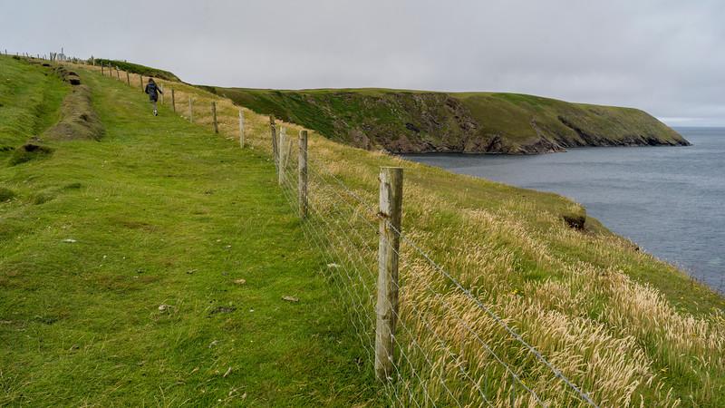 Woman walking along Erris Peninsula, Erris Head Loop Walk, Glenamoy, Belmullet, County Mayo, Ireland