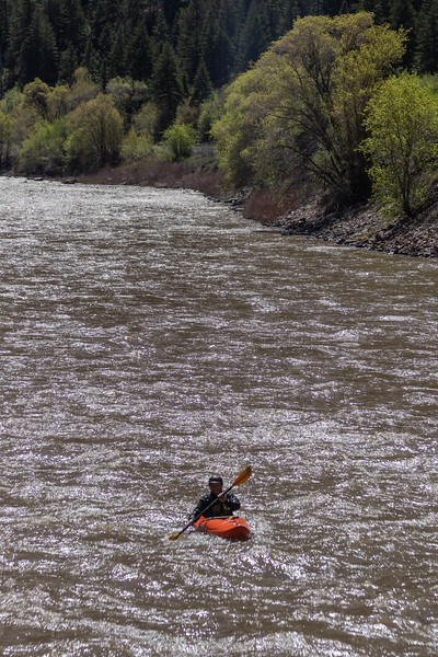 Kayaker on the Colorado River in Glenwood Canyon, Colorado, on April 27, 2019. Photo by Mitch Tobin/The Water Desk.