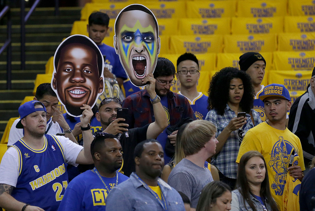 . Fans hold up signs for Golden State Warriors forward Draymond Green, left, and guard Stephen Curry before Game 1 of basketball\'s NBA Finals between the Warriors and the Cleveland Cavaliers in Oakland, Calif., Thursday, June 4, 2015. (AP Photo/Ben Margot)