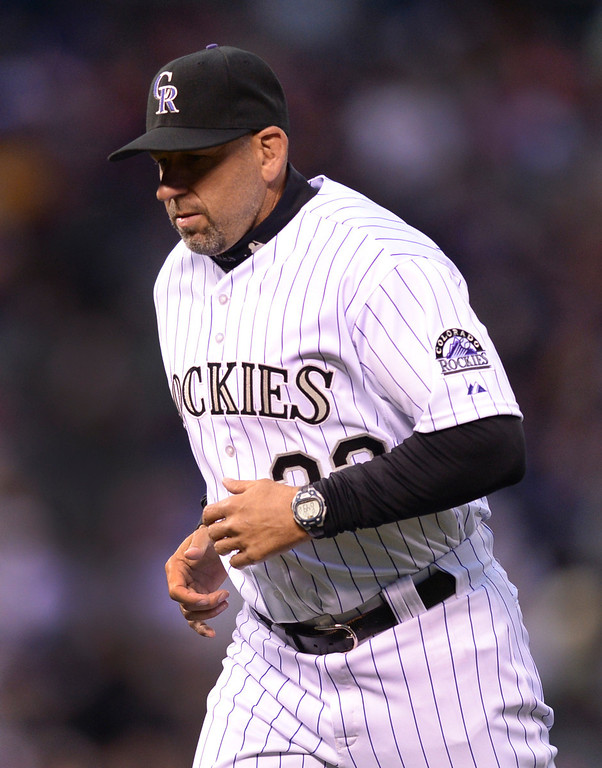. DENVER, CO - APRIL 5:  Colorado manger Walt Weiss jogged back to the dugout after questioning a call at second base in the third inning. The Colorado Rockies hosted the Arizona Diamondbacks Saturday night, April 5, 2014 in Denver. (Photo by Karl Gehring/The Denver Post)