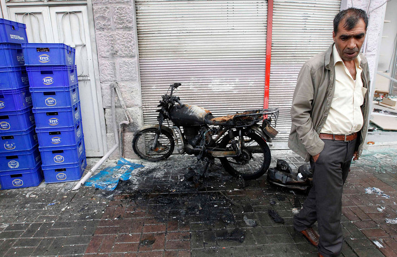 . A man stands by a burnt bike near one of the scene of the twin car bomb attacks in the town of Reyhanli of Hatay province near the Turkish-Syrian border May 12, 2013. Twin car bombs killed 43 people and wounded many more in a Turkish town near the Syrian border on Saturday and the government said it suspected Syrian involvement. The bombing increased fears that Syria\'s civil war was dragging in neighboring states despite renewed diplomatic moves towards ending two years of fighting in which more than 70,000 people have been killed. The bombs ripped into crowded streets near Reyhanli\'s shopping district in the early afternoon, scattering concrete blocks and smashing cars in the town in Turkey\'s southern Hatay province, home to thousands of Syrian refugees. REUTERS/Umit Bektas