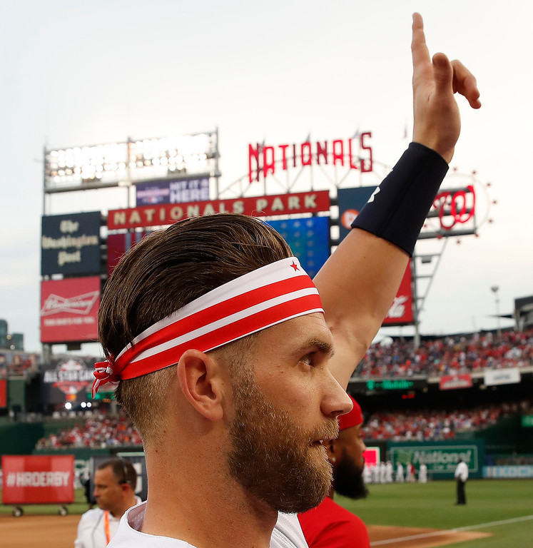 . Washington Nationals Bryce Harper (34) waves to the crowd before the MLB Home Run Derby, at Nationals Park, Monday, July 16, 2018 in Washington. The 89th MLB baseball All-Star Game will be played Tuesday. (AP Photo/Alex Brandon)