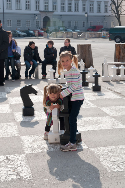 Elisabeth and Charlotte play on the giant chess board in Salzburg.