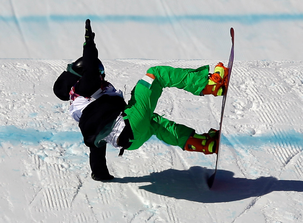 . Ireland\'s Seamus O\'Connor crashes during the men\'s snowboard slopestyle qualifying at the Rosa Khutor Extreme Park ahead of the 2014 Winter Olympics, Thursday, Feb. 6, 2014, in Krasnaya Polyana, Russia.  (AP Photo/Andy Wong)