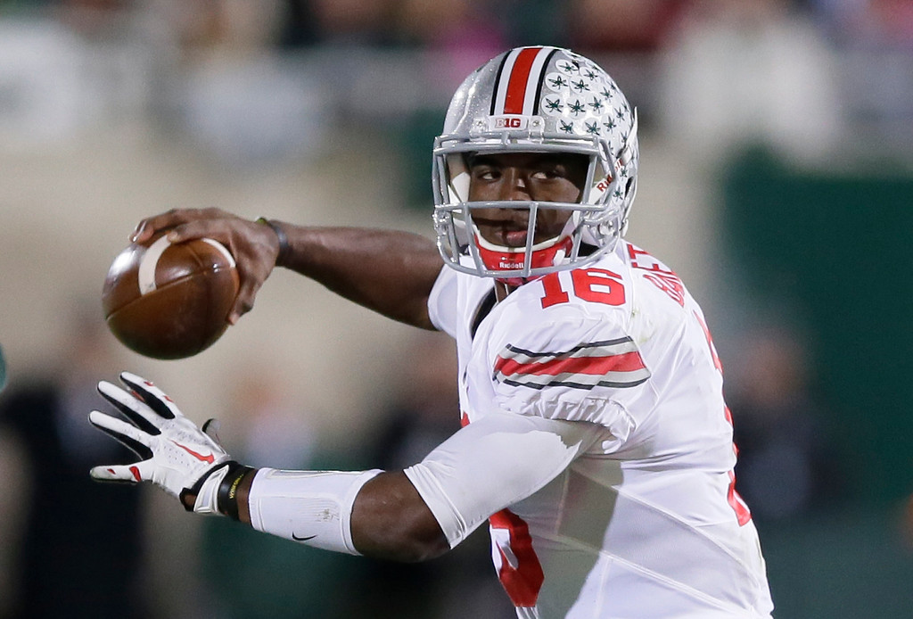 . Ohio State quarterback J.T. Barrett looks to pass during the first half of an NCAA college football game against Michigan State in East Lansing, Mich., Saturday, Nov. 8, 2014. Barrett threw for three touchdowns and ran for two in Ohio State\'s 49-37 win. (AP Photo/Carlos Osorio)