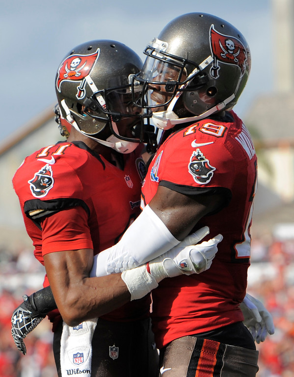 . Tampa Bay Buccaneers wide receiver Mike Williams (19) celebrates with teammate wide receiver Tiquan Underwood after catching a one-yard touchdown pass against the Philadelphia Eagles during the third quarter of an NFL football game Sunday, Dec. 9, 2012, in Tampa, Fla. (AP Photo/Brian Blanco)