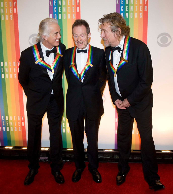 . 2012 Kennedy Center Honorees and members of the band Led Zeppelin, from left, Jimmy Page, John Paul Jones, and Robert Plant chat on the red carpet after arriving at the Kennedy Center for the Performing Arts for the 2012 Kennedy Center Honors Performance and Gala Sunday, Dec. 2, 2012 at the State Department in Washington. (AP Photo/Kevin Wolf)