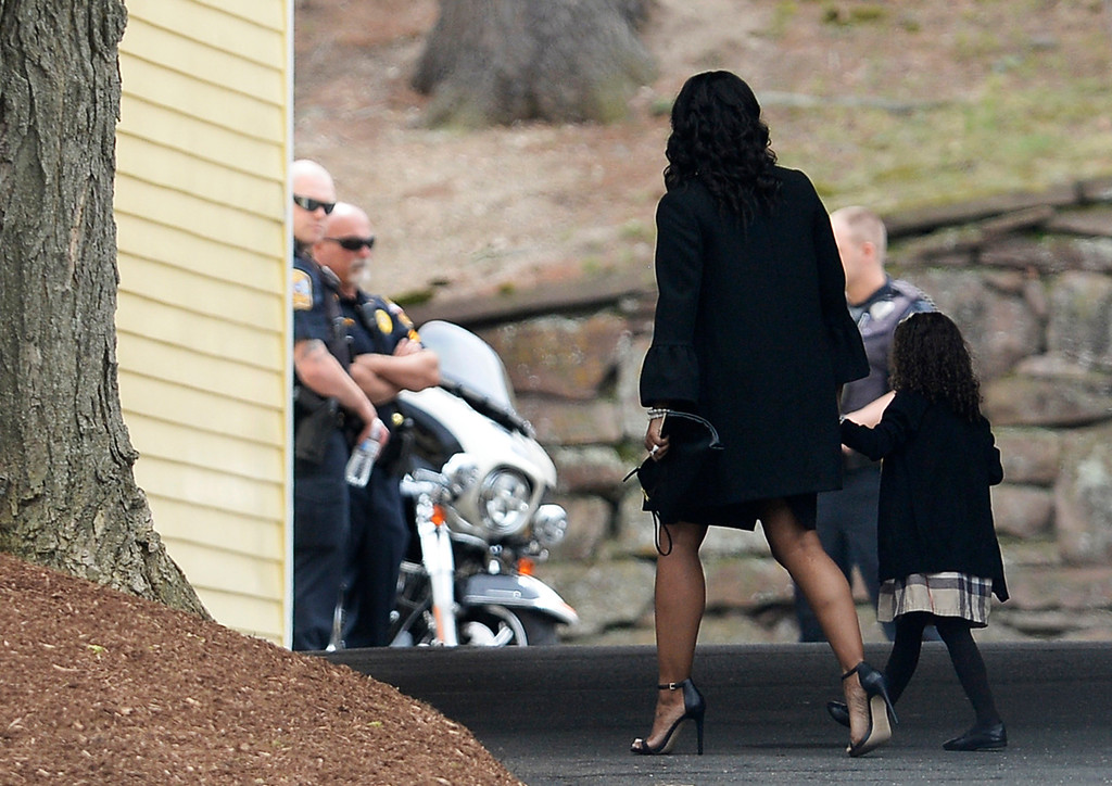 . Shayanna Jenkins Hernandez, fiancee of former New England Patriots tight end Aaron Hernandez, arrives with their daughter Avielle Janelle Hernandez for a private service for Aaron Hernandez at O\'Brien Funeral Home, Monday, April 24, 2017, in Bristol, Conn. The former New England Patriots tight end was found hanged in his cell in a maximum-security prison on Wednesday. (AP Photo/Jessica Hill)