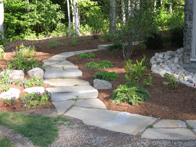 Walkway leading from east side of house to backyard