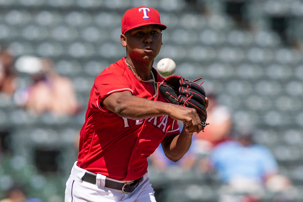. Texas Rangers relief pitcher Jose Leclerc throws to first base during the seventh inning of a baseball game against the Cleveland Indians, Sunday, July 22, 2018, in Arlington, Texas. (AP Photo/Sam Hodde)