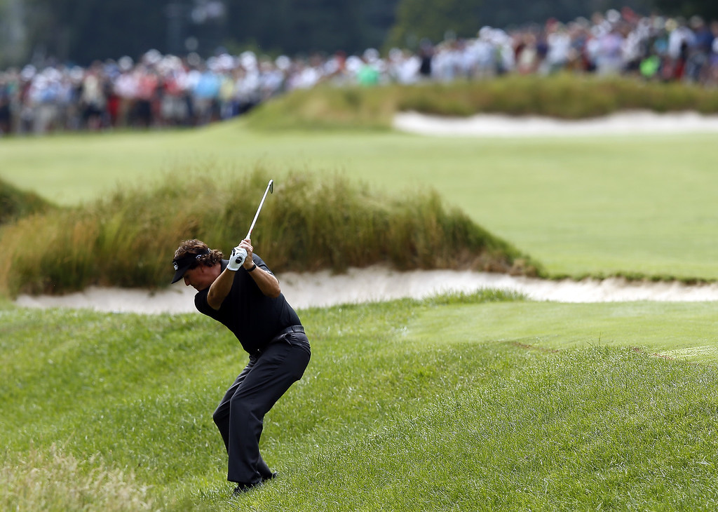 . Phil Mickelson of the United States hits a shot from the rough on the fifth hole during Round One of the 113th U.S. Open at Merion Golf Club on June 13, 2013 in Ardmore, Pennsylvania.  (Photo by Scott Halleran/Getty Images)