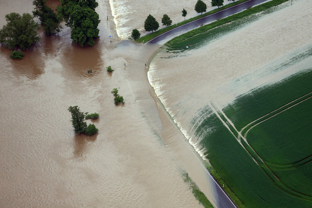 . The floods of the river Mulde have submersed a street near Leisnig, eastern Germany, Monday, June 3, 2013. Flooding has spread across a large area of central Europe following heavy rainfall in recent days. (AP Photo/dpa,  Jens Wolf)