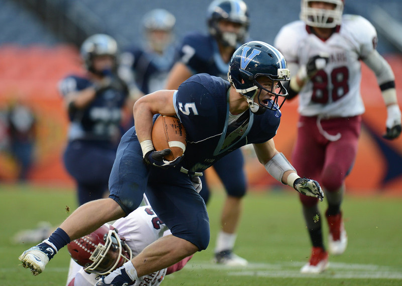 . Valor Christian RB Christian McCaffrey rushes against the Cherokee Trail defense during 5A State Championship game at Sports Authority Field at Mile High on Saturday in Denver, CO on December 1, 2012. Hyoung Chang, The Denver Post