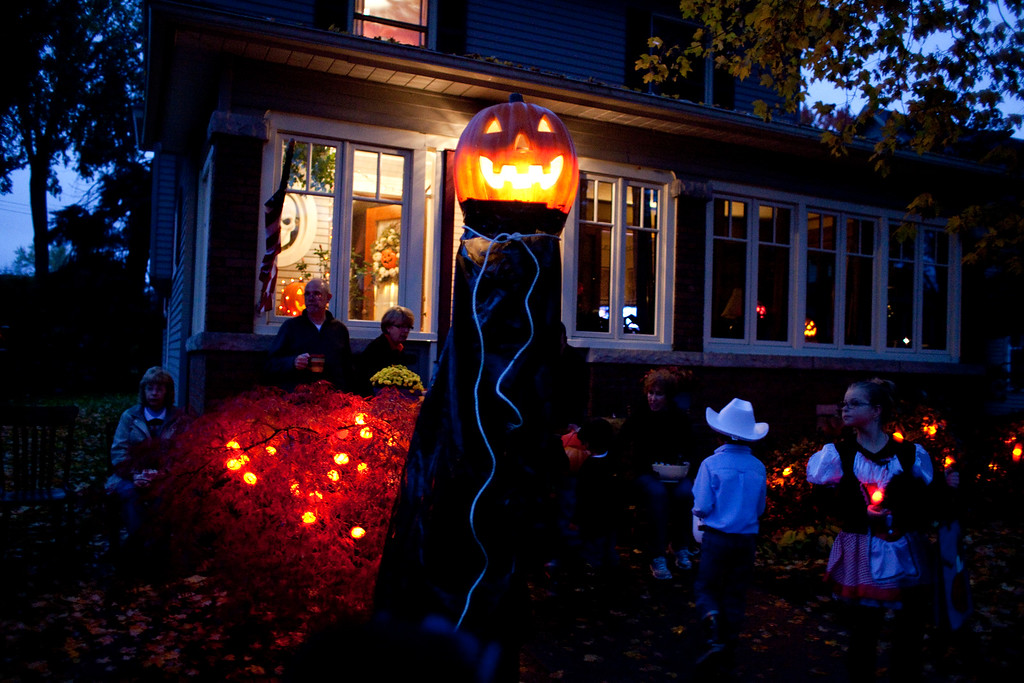 . Trick or treaters make their way up to a house on Strong Ave. in Elkhart on Thursday, Oct. 31, 2013. Despite off-and-on rain, it didn\'t stop groups of parents from taking their children door to door for candy.  (AP Photo/The Elkhart Truth, Jon Garcia)
