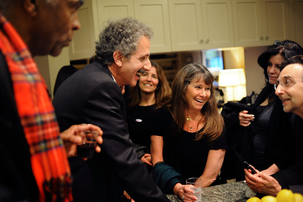 . City Attorney candidate Mike Feuer shares a laugh with supporters during his election night party in Los Angeles, CA March 5, 2013.(Andy Holzman/Los Angeles Daily News)