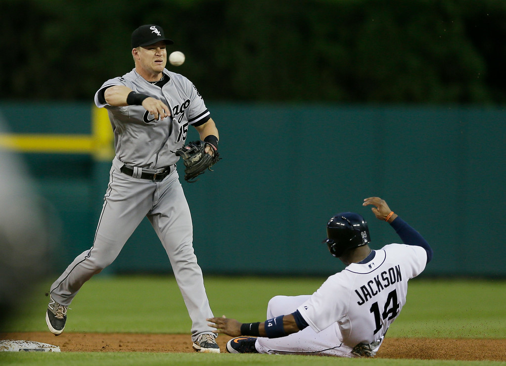 . Chicago White Sox second baseman Gordon Beckham completes a double play as he tags Detroit Tigers\' Austin Jackson and throws to first for the out on Ian Kinsler during the third inning of a baseball game, Wednesday, July 30, 2014 in Detroit. (AP Photo/Carlos Osorio)