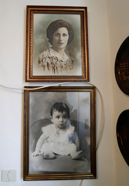. Black and white photos showing Emma Morano when she was 18 months and when she was 43-year old,  are seen in her home during the day of her birthday in Verbania, Italy, Tuesday, Nov. 29, 2016.  At 117 years of age, Emma is now the oldest person in the world and is believed to be the last surviving person in the world who was born in the 1800s, coming into the world on Nov. 29, 1899. (AP Photo/Antonio Calanni)