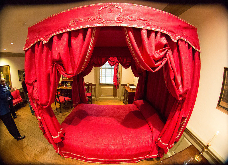 A covered bed in the Chippendale Bedroom