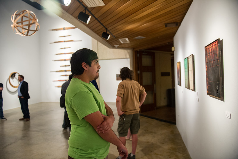 Trenton Oliver observes the art in the Weil Gallery