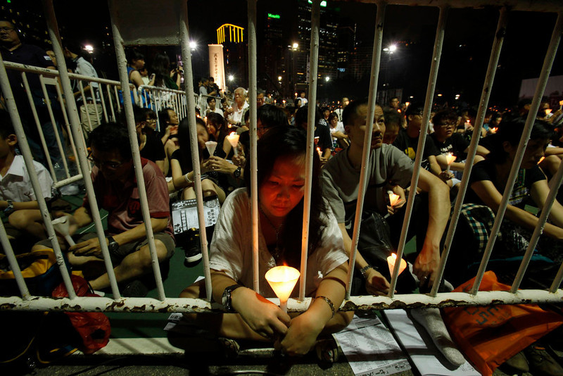 . Protesters participate in a candlelight vigil at Hong Kong\'s Victoria Park June 4, 2013, to mourn those who died in a military crackdown on pro-democracy movement at Beijing\'s Tiananmen Square in 1989. Tuesday marks the 24th anniversary of the military crackdown of the movement  REUTERS/Bobby Yip
