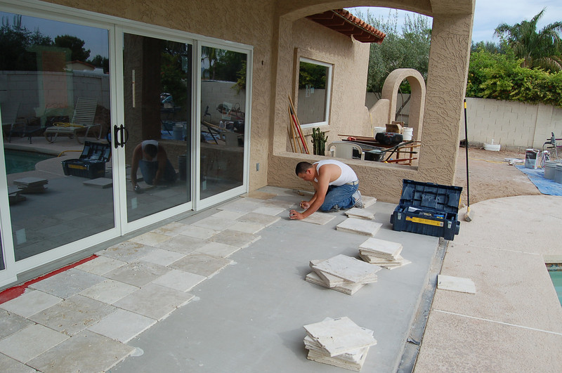 The travertine flowed out of the living room onto the patio. We want the patio to be an extension of the living room.