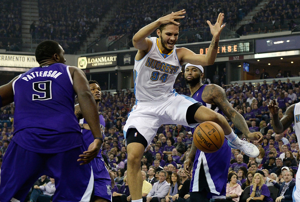 . SACRAMENTO, CA - OCTOBER 30:  Evan Fournier #94 of the Denver Nuggets has the ball slapped out of his hand by Patrick Patterson #9 of the Sacramento Kings during the second quarter at Sleep Train Arena on October 30, 2013 in Sacramento, California. NOTE TO USER: User expressly acknowledges and agrees that, by downloading and or using this photograph, User is consenting to the terms and conditions of the Getty Images License Agreement.  (Photo by Thearon W. Henderson/Getty Images)