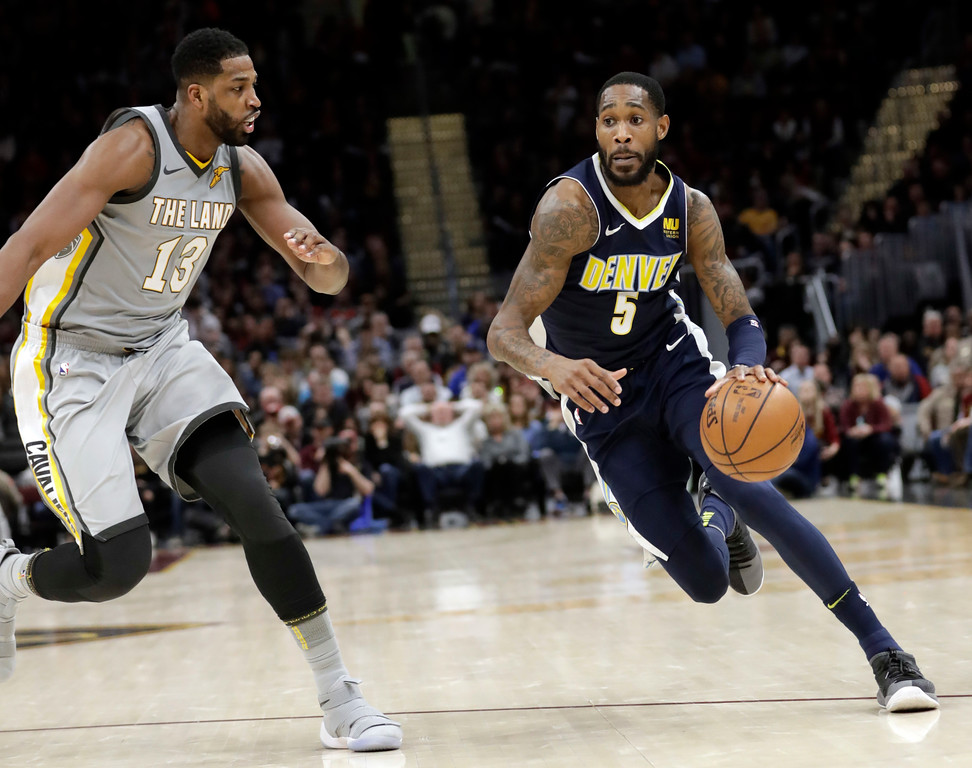 . Denver Nuggets\' Will Barton (5) drives past Cleveland Cavaliers\' Tristan Thompson (13) in the second half of an NBA basketball game, Saturday, March 3, 2018, in Cleveland. The Nuggets won 126-117. (AP Photo/Tony Dejak)