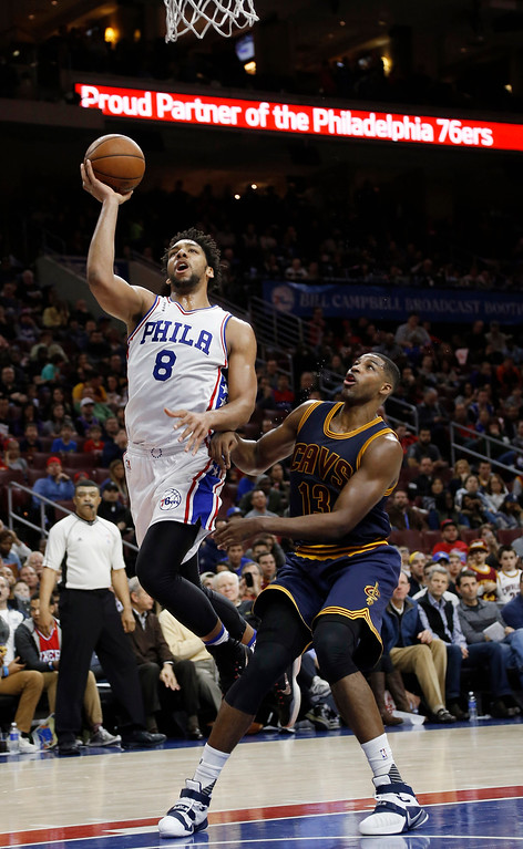 . Philadelphia 76ers\' Jahlil Okafor, left, goes up for a shot against Cleveland Cavaliers\' Tristan Thompson during the second half of an NBA basketball game, Sunday, Jan. 10, 2016, in Philadelphia. Cleveland won 95-85. (AP Photo/Matt Slocum)
