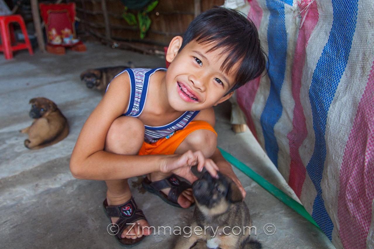 Boy with Puppies, Mekong Delta, Vietnam